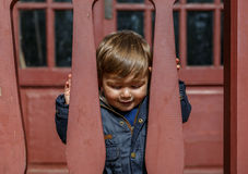 A beautiful child looks down attentively Royalty Free Stock Photos