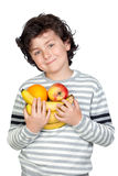 Beautiful child with many fruits Stock Image