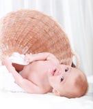 Beautiful child play wicker baskets Stock Photos