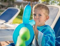 Amazing kid plays with balloons royalty free stock photo