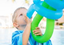Wonderful child plays with balloons stock image