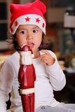 Beautiful  child plays with Santa Claus decoration Stock Photo