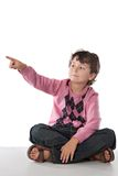 Beautiful child pointing with his finger Stock Photography