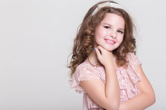 Beautiful child portrait, little girl smiling, studio Royalty Free Stock Photography