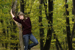 beautiful child posing with trees Royalty Free Stock Photography