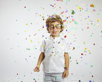 Beautiful child with rimmed glasses and confetti Royalty Free Stock Image