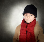 Beautiful child with scarf and wool hat Royalty Free Stock Photography