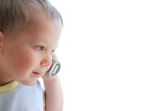 The beautiful child speaking by phone. The beautiful child on a white background speaking by phone Royalty Free Stock Photo