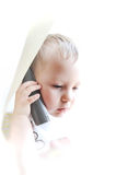 The beautiful child speaking by phone. The beautiful child on a white background speaking by phone Stock Image