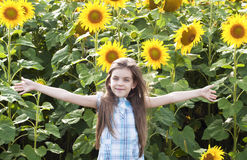 Beautiful child with sunflower Stock Photo