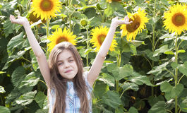 Beautiful child with sunflower Royalty Free Stock Image