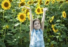 Beautiful child with sunflower Stock Image