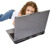Beautiful child using a laptop Royalty Free Stock Photos