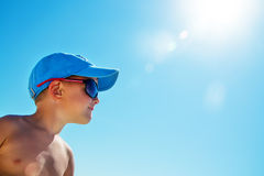 Beautiful child wearing blue cap on beach Royalty Free Stock Photos