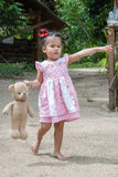 Beautiful child wearing white dress and bear Stock Photography