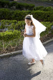 Beautiful child in white dress holding rosary Royalty Free Stock Photo