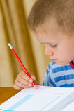 Beautiful child writing Royalty Free Stock Photos