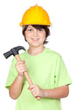 Beautiful child with yellow helmet and hammer Stock Images