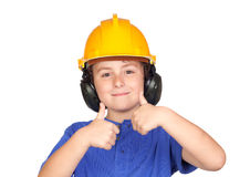 Beautiful child with yellow helmet saying OK Royalty Free Stock Images
