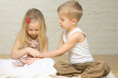 Beautiful children and cat Royalty Free Stock Photos