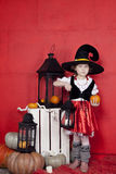 Beautiful children on Halloween in the studio. Children and interior for Halloween Royalty Free Stock Photography