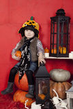 Beautiful children on Halloween in the studio. Children and interior for Halloween Royalty Free Stock Images
