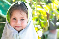 Beautiful children headshot with towel Royalty Free Stock Photography