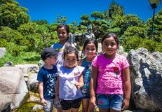 Beautiful Children posing at Park,  Buenos Aires, Argentina. Buenos Aires Argentina - Dec 26, 2018: Beautiful Children posing at Park in  Buenos Aires, Argentina stock photo