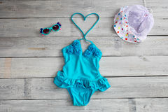Beautiful children`s bathing suit  swimsuit, hat and sunglasse Stock Images