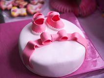 Beautiful children`s pink cake for a newborn girl stock photography