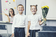 Beautiful children school children with flowers for the teachers Royalty Free Stock Photos