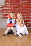Beautiful children sit on the bag Royalty Free Stock Image