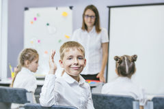 Beautiful children are students together in a classroom in school get the education with the teacher stock images