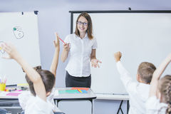 Beautiful children are students together in a classroom in schoo. L get the education with the teacher Royalty Free Stock Photography