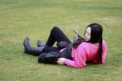 Beautiful china girl Lie on the grass Stock Photo