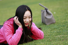 Beautiful china girl Lie on the grass Stock Photos