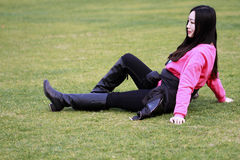 Beautiful china girl Lie on the grass Stock Images