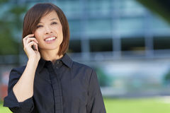 Beautiful Chinese Asian Woman On Her Cell Phone Royalty Free Stock Image