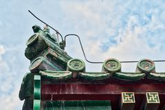Beautiful Chinese eaves with symbolic tile sculptures Stock Photo