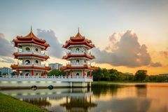 Twin towers under sunset stock images
