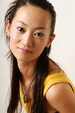 Beautiful Chinese girl. In yellow gilet Royalty Free Stock Images