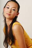 Beautiful Chinese girl. In yellow gilet stock images