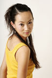 Beautiful Chinese girl. In yellow gilet Royalty Free Stock Photos