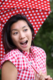 Beautiful Chinese girl surprised with an umbrella. A young beautiful Chinese woman with a dotted umbrella and shirt in Odaiba, Tokyo, Japan, 2009 Stock Photos