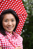 Beautiful Chinese happy with umbrella. A young beautiful Chinese woman with a dotted umbrella and shirt in Odaiba, Tokyo, Japan, 2009 Stock Photos