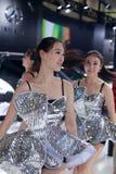Beautiful chinese models dancing at infiniti car booth Stock Images