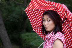 Beautiful Chinese smiling mysteriously Royalty Free Stock Photos