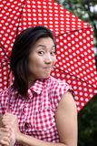 Beautiful Chinese with umbrella and a curious look Stock Image