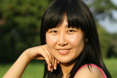 Beautiful Chinese woman. In summer time Stock Images