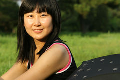 Beautiful Chinese woman. In summer time Stock Image